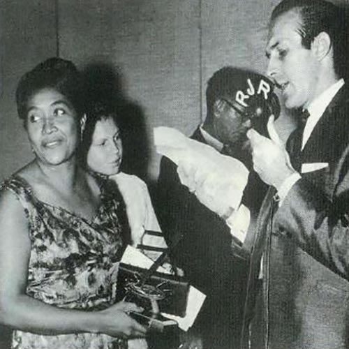 Sonia Pottinger receiving an award (with Tony Verity of R.J.R.)