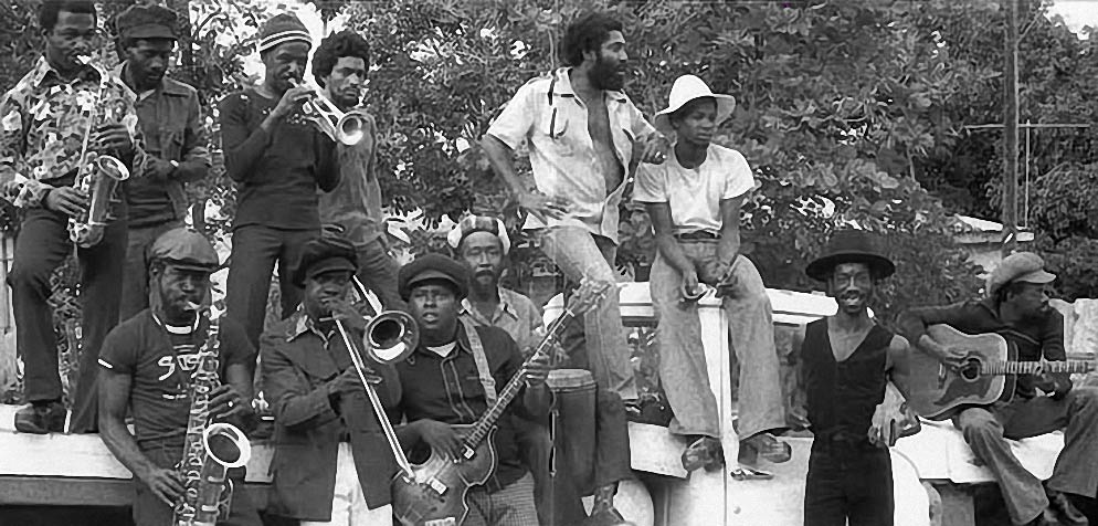 The Black Disciples with Bobby Ellis on trumpet, third left from back