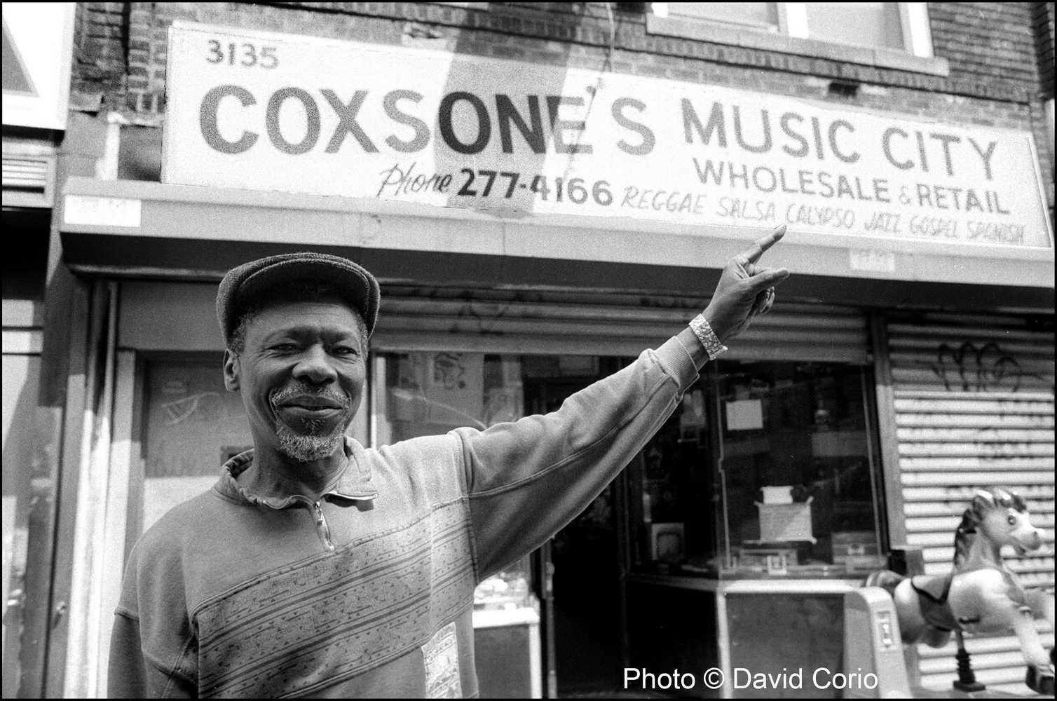 Clement 'Coxsone' Dodd outside his Brooklyn record shop and studio 8-19-1992 by David Corio