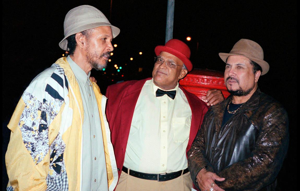 Willi Williams, Bunny Lee & Dennis Alcapone outside the Caribbean Club, Green Lanes, London August 2004. (Photo: David Corio)